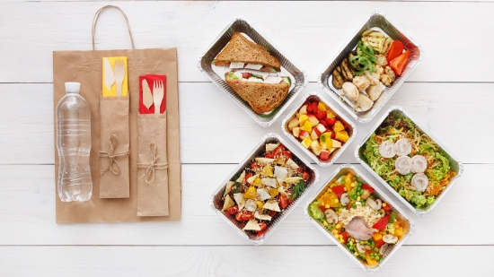 food in grab n go boxes with paper bag for sustainable carrying