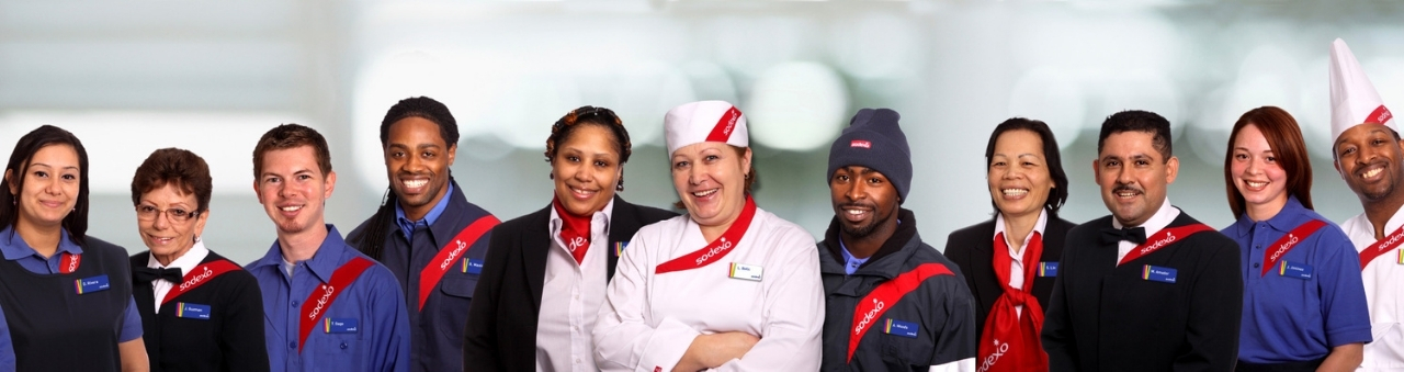 diverse group of sodexo employees wearing uniforms posing for camera